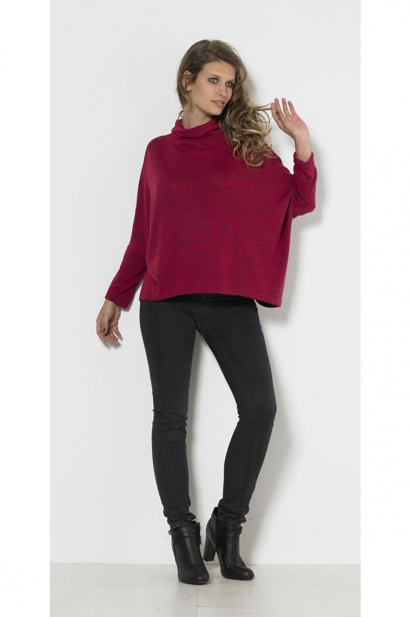 Pull off the original batwing sleeves and turtleneck