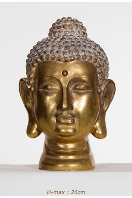 Statue head of Buddha, peace and positive atmosphere, gold color, made serene