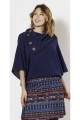 Poncho type sweater in wide knit and wood buttons